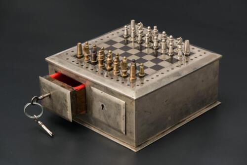 The travel chess set with a metal box-board and magnetic pieces