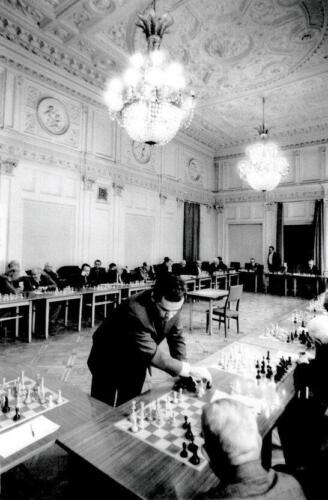 The 13th World Champion Garry Kasparov is giving a simultaneous exhibition in the Great Hall, 1994