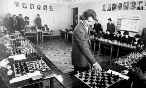 The 10th World Champion Boris Spassky is giving a simultaneous exhibition in the Portrait Gallery (now the Exhibition Hall) of the Central Chess Club